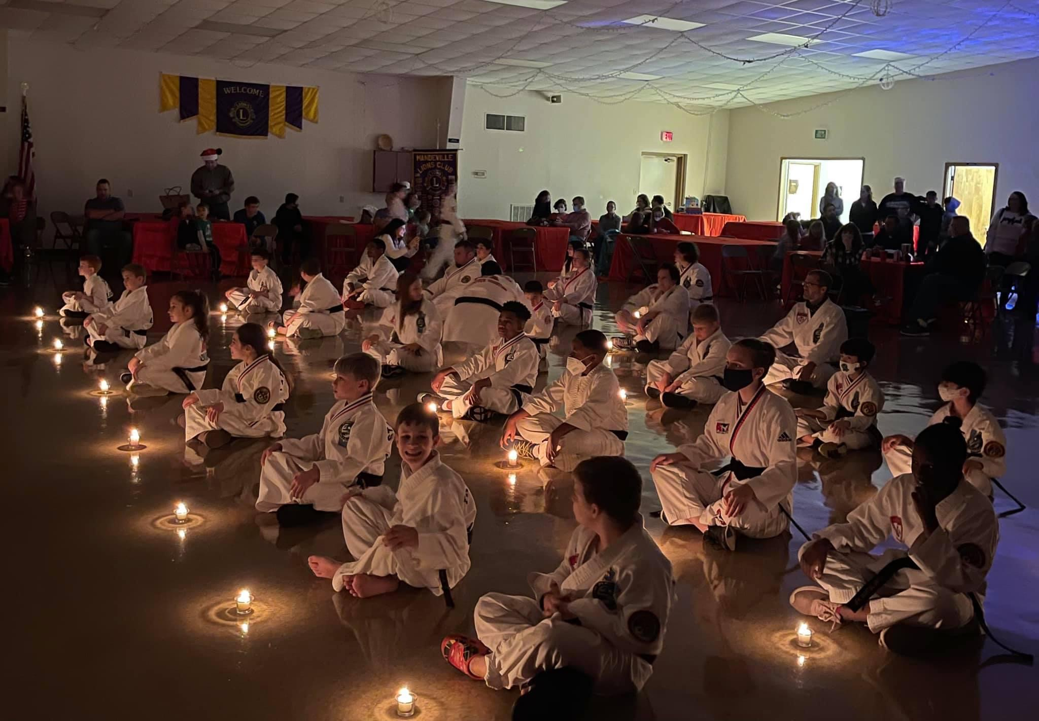 JFK Martial Arts students with their black belt candles.